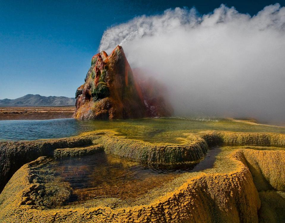"<p>Encapsulating Bob Ross's famed saying ""happy little accidents,"" Fly Geyser was created by mistake during the incorrect drilling of a well. The multi-colored water that plumes from the geyser is actually the result of multiple mineral deposits like algae and sulfur. The prismatic water and bizarre shape of the geyser give it an otherworldly feel that you have to experience to understand.</p>"