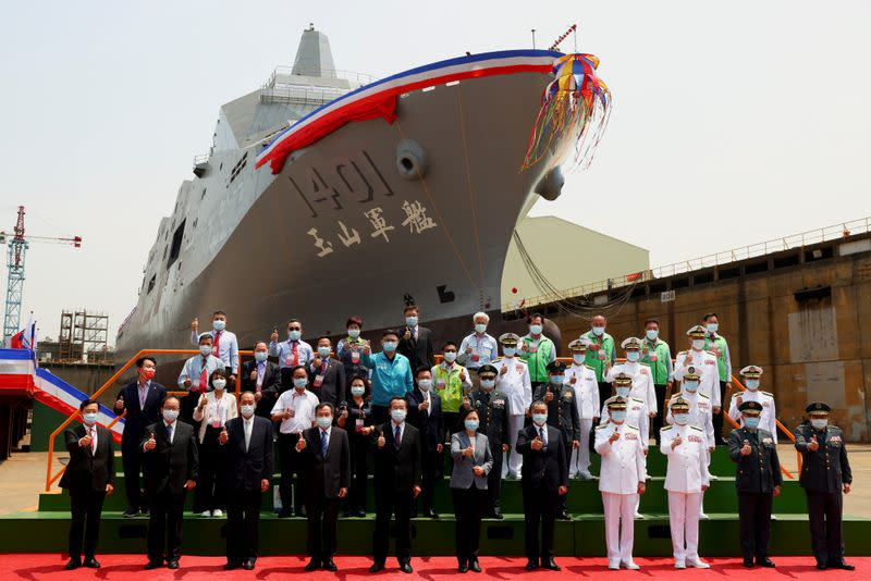 "Taiwan's President Tsai Ing-wen poses for a group photo in front of Taiwan Navy's domestically built amphibious transport dock ""Yushan"" during its launching ceremony in Kaohsiung"