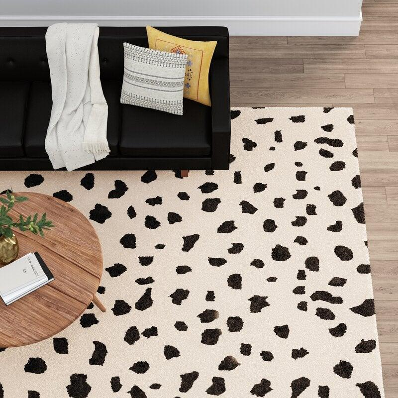 "<br><br><strong>AllModern</strong> Grady Animal Print Handmade Tufted Wool Rug (4' x 6'), $, available at <a href=""https://go.skimresources.com/?id=30283X879131&url=https%3A%2F%2Fwww.wayfair.com%2Frugs%2Fpdp%2Fallmodern-grady-animal-print-handmade-tufted-wool-beigeblack-area-rug-w003527831.html%3Fpiid%3D1965526272"" rel=""nofollow noopener"" target=""_blank"" data-ylk=""slk:Wayfair"" class=""link rapid-noclick-resp"">Wayfair</a>"