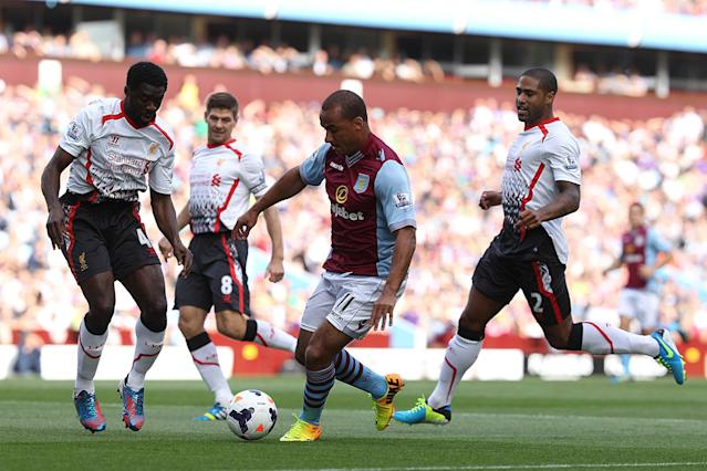 Aston Villa's Gabriel Agbonlahor (centre) is surrounded by Liverpool's Kolo Toure (left) and Glen Johnson (right)