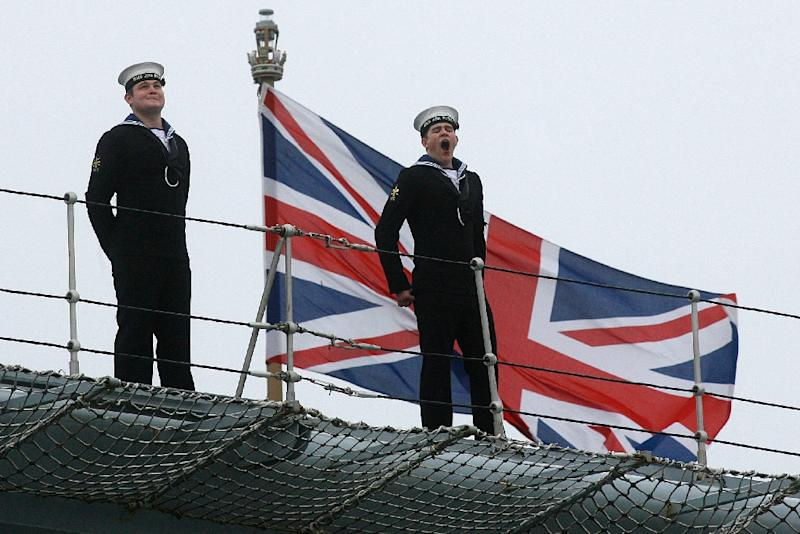 A naval officer stands on the flight deck of British aircraft carrier HMS Ark Royal, in Portsmouth, southern England on November 5, 2010 (AFP Photo/Richard Pohle)