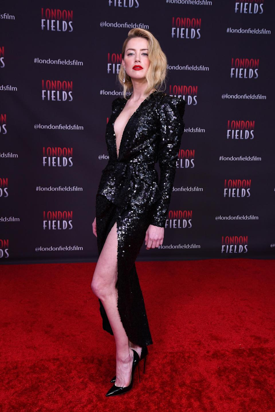<p>Amber posed on the red carpet wearing a shimmery Elie Saab number at the 'London Fields' premiere in Los Angeles. <em>[Photo: Getty]</em> </p>