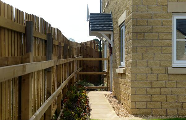 The huge fence was erected around the property (SWNS)
