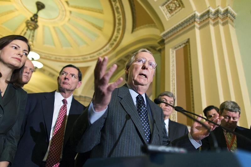 Senate Minority Leader Mitch McConnell, R-Ky., speaks with reporters following a Republican strategy session at the Capitol in Washington, Tuesday, Jan. 22, 2013. From left to right are Sen. Kelly Ayotte, R-N.H., Sen. Jerry Moran, R-Kan., Sen. John Barrasso, R-Wyo., Sen.  Mitch McConnell, R-Ky., and Sen. Roy Blunt, R-Mo.  (AP Photo/J. Scott Applewhite)