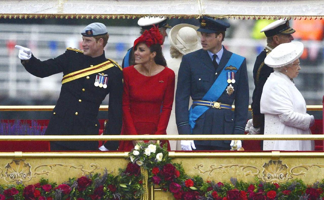 Britain's Kate Duchess of Cambridge, 2nd left, stands next to Prince Harry, left Prince William, 3rd left, and Queen Elizabeth as they watch the proceeding onboard the Royal barge during the Queen's Diamond Jubilee Pageant on the River Thames in London Sunday June 3, 2012. More than 1,000 boats will sail down the River Thames on Sunday in a flotilla tribute to Queen Elizabeth II's 60 years on the throne that organizers are calling the biggest pageant on the river for 350 years. (AP Photo/Dylan Martinez, Pool)