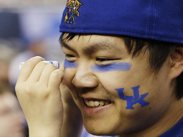 Kentucky fan Joe Chen has his face painted before the NCAA Final Four tournament college basketball championship game against Connecticut Monday, April 7, 2014, in Arlington, Texas. (AP Photo/David J. Phillip)