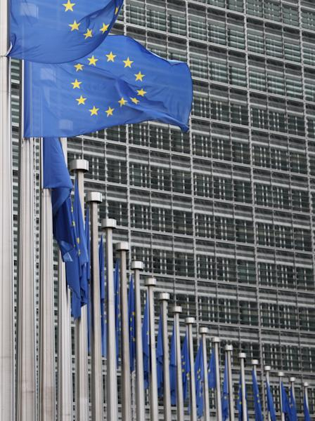 European Union flags wave in the wind outside EU headquarters in Brussels. The European Union has won the Nobel Peace Prize, it has been announced on Friday, Oct. 12, 2012. (AP Photo/Yves Logghe)