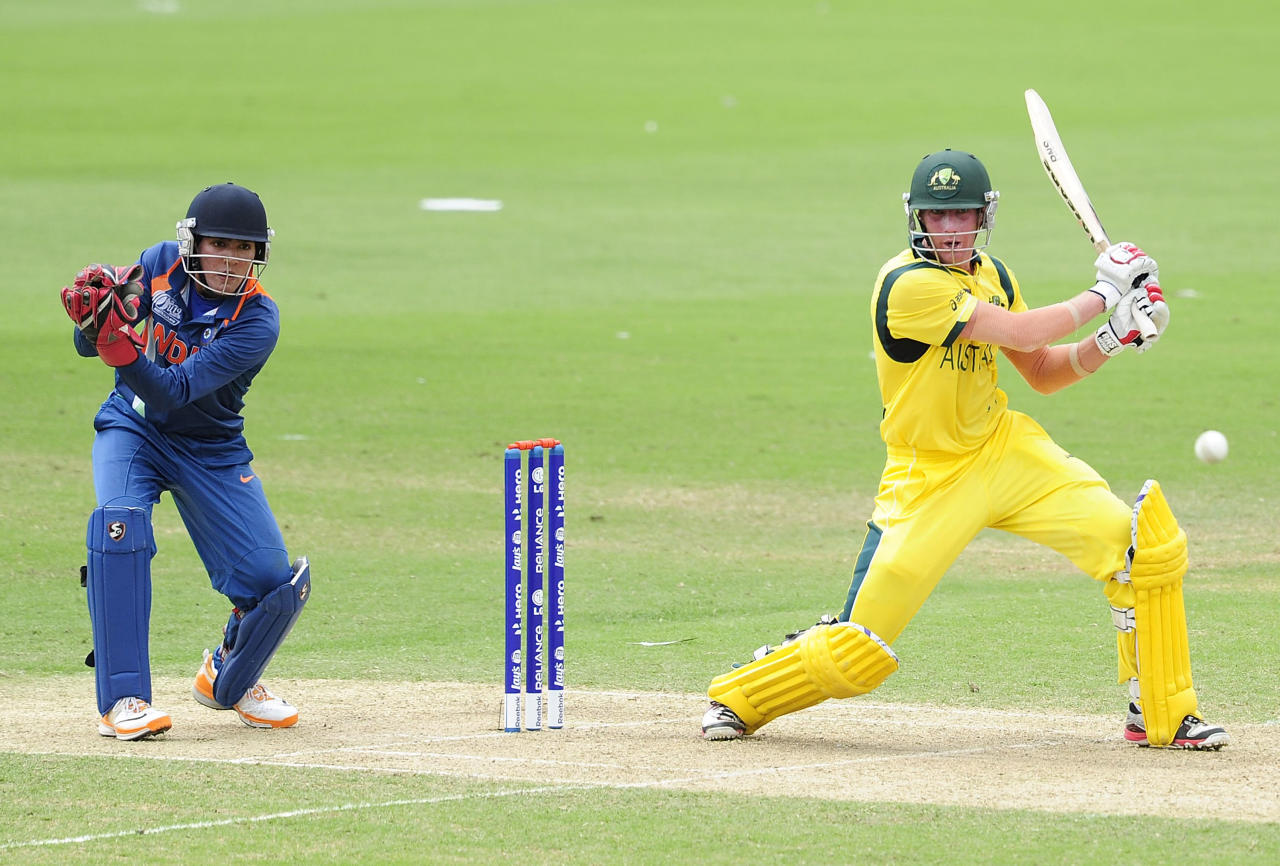TOWNSVILLE, AUSTRALIA - AUGUST 26:  William Bosisto of Australia bats in front of Smit Patel of India during the 2012 ICC U19 Cricket World Cup Final between Australia and India at Tony Ireland Stadium on August 26, 2012 in Townsville, Australia.  (Photo by Ian Hitchcock-ICC/Getty Images)