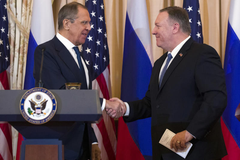 Secretary of State Mike Pompeo, right, shakes hands with Russian Foreign Minister Sergey Lavrov, after a media availability at the State Department, Tues. Dec. 10, 2019 in Washington. (Photo: Alex Brandon/AP)