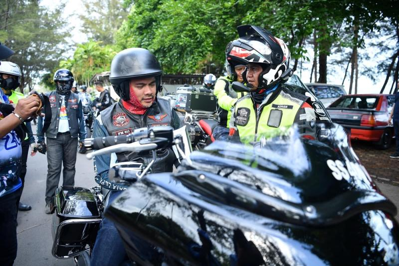 Deputy Home Minister Datuk Mohd Azis Jamman (left) on his motorbike at an anti-drug awareness programme before he met with an accident about an hour later — Photo courtesy of Home Ministry