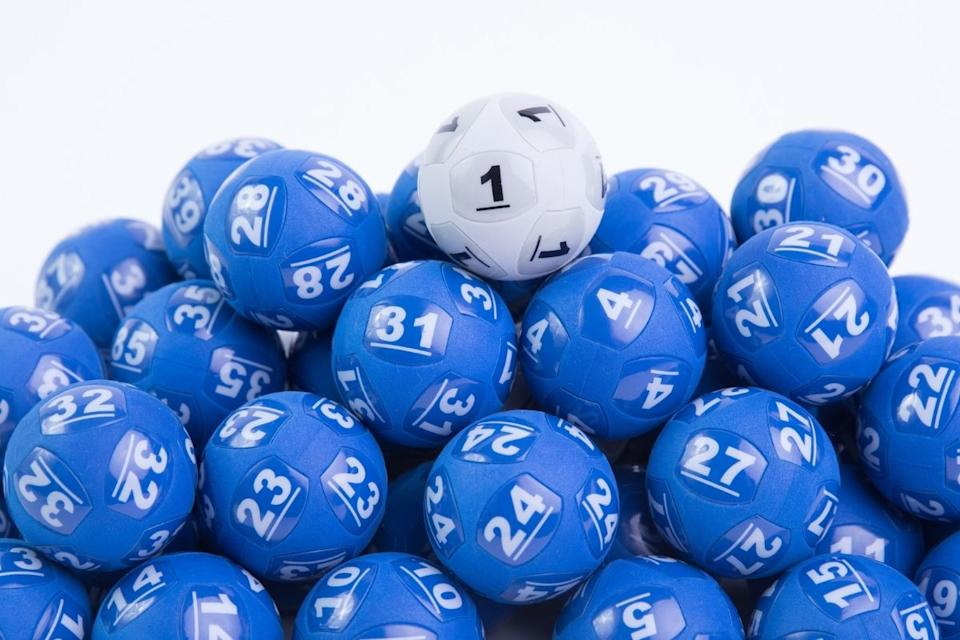 white powerball sits atop group of blue powerballs
