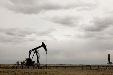 Oil slips below $45 on demand concerns, set for weekly rise