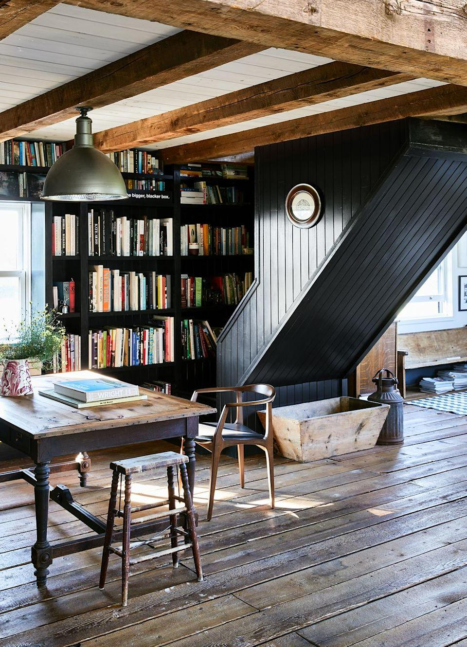 <p>To embrace your home's unique architecture, opt for simple black shelves with just enough space for your best reads. </p>