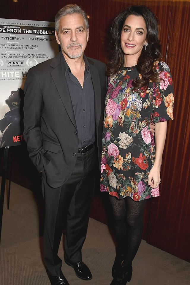 <p>The Clooneys attended a screening of the Clooney Foundation for Justice, in London. She wore a Dolce & Gabbana dress.</p>