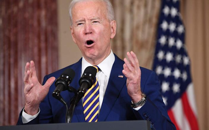Joe Biden says the rate of vaccination had to be accelerated - AFP