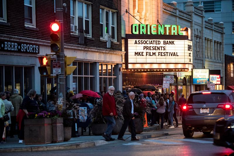 Theatergoers line the street for the Milwaukee Film Festival at the Oriental Theatre.
