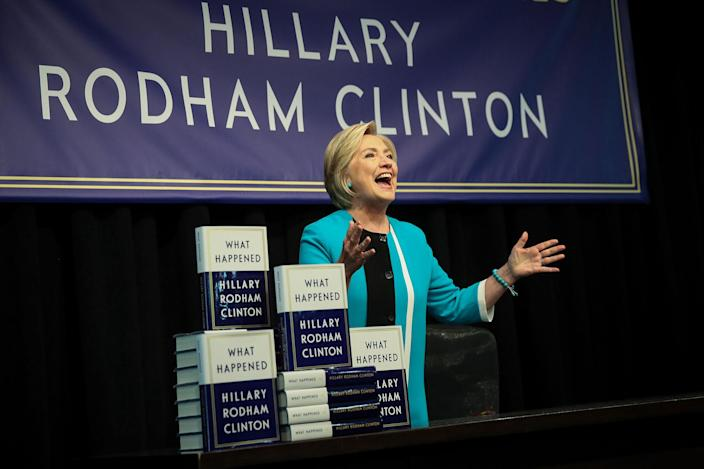 """<p>SEPT. 12, 2017 – Former U.S. Secretary of State Hillary Clinton acknowledges the audience as she arrives onstage to sign copies of her new book """"What Happened"""" during an event at Barnes and Noble bookstore in New York City. Clinton's book focuses on her 2016 election loss to President Donald Trump. (Photo: Drew Angerer/Getty Images) </p>"""