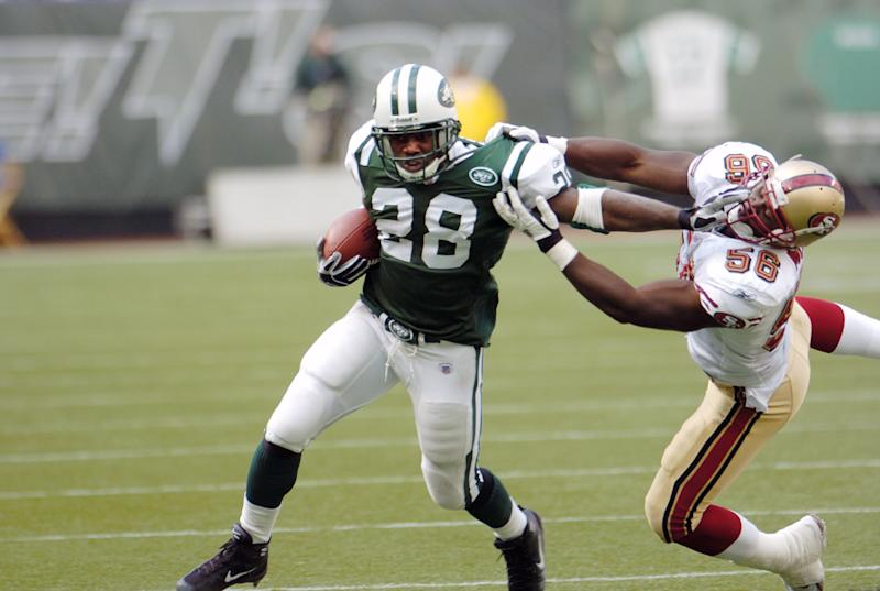 UNITED STATES - OCTOBER 17: New York Jets' running back Curtis Martin keeps a San Francisco 49ers defender at a safe distance in a game at Giants Stadium. Martin racked up 111 yards and two touchdowns on 25 carries at the Jets came from behind in the second half to win, 22-14. They're now 5-0 on the season for the first time in their 45-year history. (Photo by Andrew Savulich/NY Daily News Archive via Getty Images)