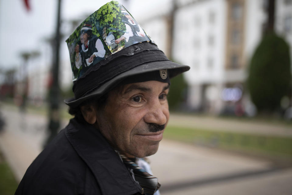 Belhussein Abdelsalam, a Charlie Chaplin impersonator pauses while waiting for customers in an avenue in Rabat, Morocco, Wednesday, Dec. 16, 2020. When 58-year-old Moroccan Belhussein Abdelsalam was arrested and lost his job three decades ago, he saw Charlie Chaplin on television and in that moment decided upon a new career: impersonating the British actor and silent movie maker remembered for his Little Tramp character. (AP Photo/Mosa'ab Elshamy)