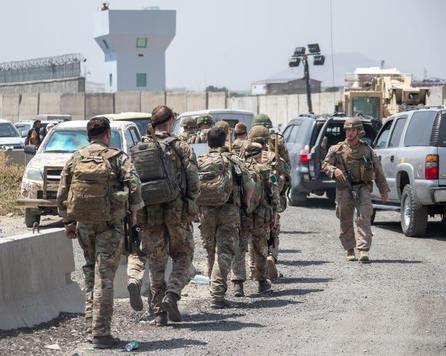 Members of the UK Armed Forces taking part in the evacuation of entitled personnel from Kabul airport in Afghanistan (LPhot Ben Shread/MoD/Crown Copyright/PA)