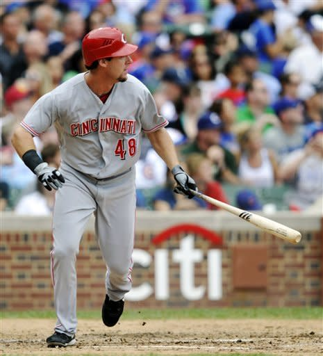 Cincinnati Reds' Ryan Ludwick (48) watches his solo home run against the Chicago Cubs during the sixth inning of a baseball game, Sunday, Aug. 12, 2012, in Chicago. (AP Photo/Jim Prisching)