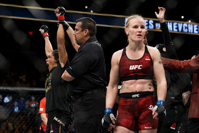 EDMONTON, AB – SEPTEMBER 09: Amanda Nunes, left, reacts after defeating Valentina Shevchenko, right, during UFC 215 at Rogers Place on September 9, 2017 in Edmonton, Canada. (Getty Images)