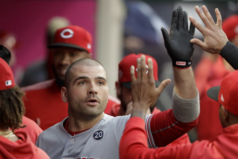 Cincinnati Reds' Joey Votto celebrates in the dugout after his home run against the Los Angeles Angels during the first inning of a baseball game in Anaheim, Calif., Tuesday, June 25, 2019. (AP Photo/Chris Carlson)