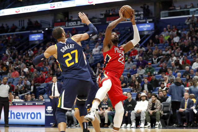 New Orleans Pelicans forward Derrick Favors (22) shoots over Utah Jazz center Rudy Gobert (27) in the first half of an NBA basketball game in New Orleans, Monday, Jan. 6, 2020. (AP Photo/Tyler Kaufman)