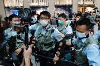 Police officers ask people to leave during a protest after China's parliament passes a national security law for Hong Kong