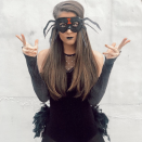 """<p>While you could get away with just the mask, a velvet shirt and a feathery black skirt help complete the look. </p><p><a class=""""link rapid-noclick-resp"""" href=""""https://www.instagram.com/p/B4TMiMHAOJB/"""" rel=""""nofollow noopener"""" target=""""_blank"""" data-ylk=""""slk:SEE MORE"""">SEE MORE</a></p><p><a class=""""link rapid-noclick-resp"""" href=""""https://www.amazon.com/Forum-Novelties-Mask-Spider-Eyeglass-73646/dp/B00KSSGX8C?tag=syn-yahoo-20&ascsubtag=%5Bartid%7C10072.g.33547559%5Bsrc%7Cyahoo-us"""" rel=""""nofollow noopener"""" target=""""_blank"""" data-ylk=""""slk:SHOP SPIDER MASK"""">SHOP SPIDER MASK</a></p>"""
