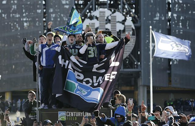 Seattle Seahawks fans cheer during the parade for the NFL football Super Bowl champions, Wednesday, Feb. 5, 2014, in Seattle. The Seahawks defeated the Denver Broncos 43-8 in Super Bowl XLVIII on Sunday. (AP Photo/Elaine Thompson)