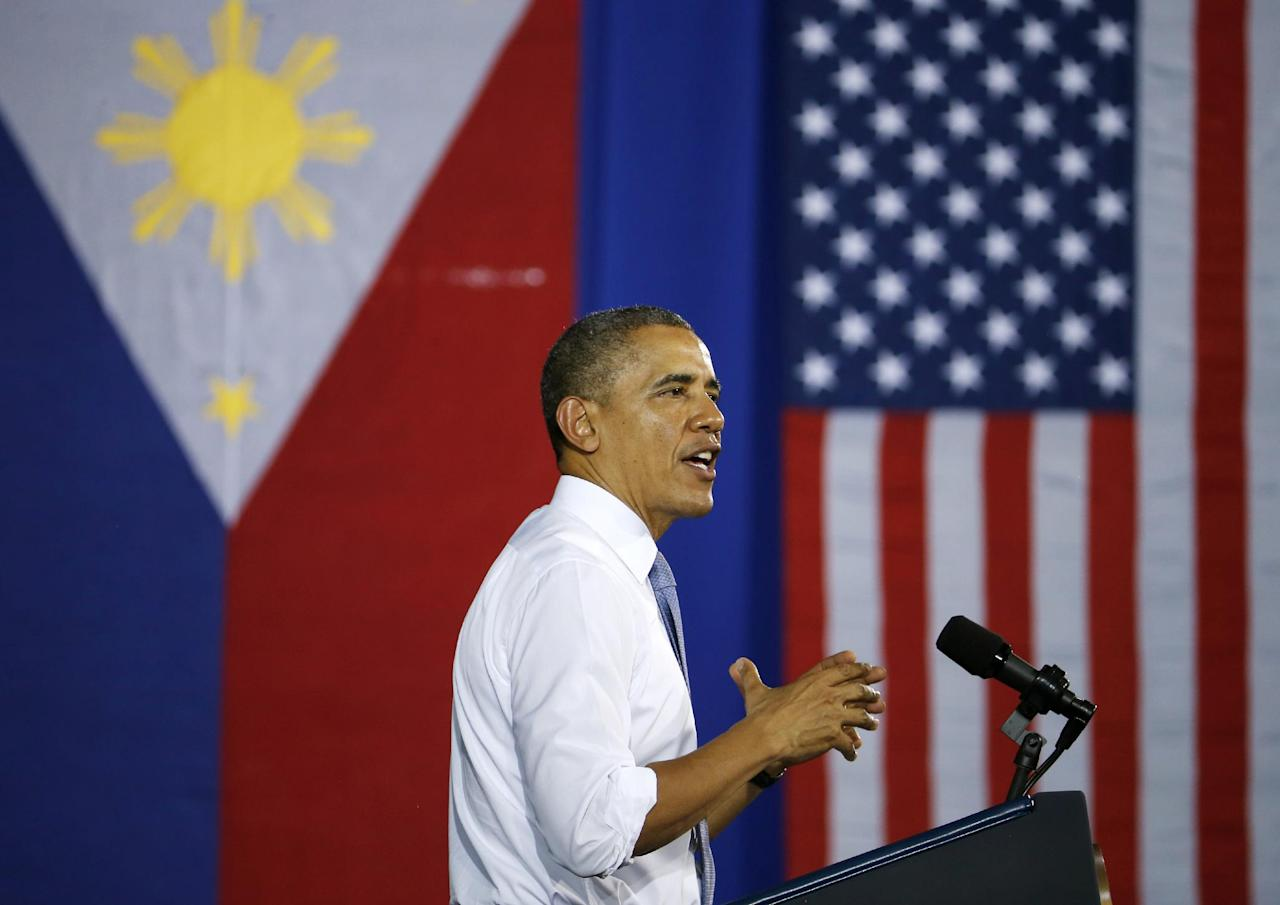 President Barack Obama addresses U.S. and Philippine troops at Fort Bonifacio in Manila, the Philippines, Tuesday, April 29, 2014. Obama is wrapping up his four country eight day tour of Asia. (AP Photo/Charles Dharapak)