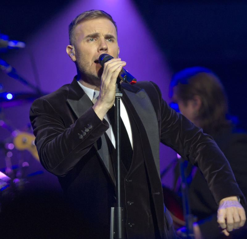 "FILE - This Dec. 6, 2011 file photo shows British singer-songwriter Gary Barlow performing during a fund-raising concert attended by Britain's Prince William and Catherine, Duchess of Cambridge, Prince Charles, Prince of Wales and his wife Camilla, Duchess of Cornwall, at the Royal Albert Hall in London. Barlow and his wife Dawn say their daughter was stillborn, and are asking for privacy ""at this painful time."" In a statement released Monday, Aug. 6, 2012, the couple said they were devastated by the loss of Poppy Barlow, who was delivered stillborn on Saturday.  They said their focus is  ""on giving her a beautiful funeral and loving our three children with all our hearts."" The couple have a son and two daughters. (AP Photo/Arthur Edwards, file)"