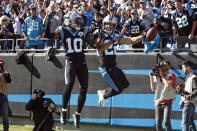 Carolina Panthers running back Christian McCaffrey (22) and wide receiver Curtis Samuel (10) celebrate McCaffrey's touchdown against the Tennessee Titans during the first half of an NFL football game in Charlotte, N.C., Sunday, Nov. 3, 2019. (AP Photo/Brian Blanco)