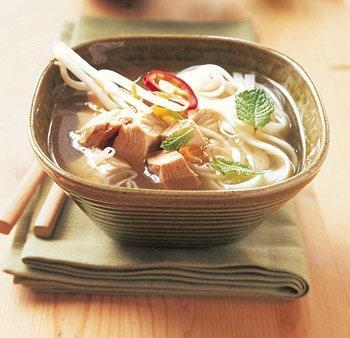 """Soup is just the thing for the day after a big feast, perhaps that's why so many of our best leftover turkey recipes start with broth. This Vietnamese-inspired version is filled with turkey, fresh ginger, chiles, and mint leaves, plus a little fish sauce for savory depth. <a href=""""https://www.epicurious.com/recipes/food/views/asian-turkey-noodle-soup-with-ginger-and-chiles-231068?mbid=synd_yahoo_rss"""" rel=""""nofollow noopener"""" target=""""_blank"""" data-ylk=""""slk:See recipe."""" class=""""link rapid-noclick-resp"""">See recipe.</a>"""