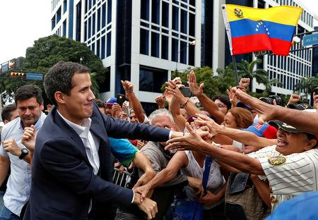 Juan Guaido, President of Venezuela's National Assembly, greets supporters during a rally against Venezuelan President Nicolas Maduro's government and to commemorate the 61st anniversary of the end of the dictatorship of Marcos Perez Jimenez in Caracas, Venezuela January 23, 2019. REUTERS/Carlos Garcia Rawlins