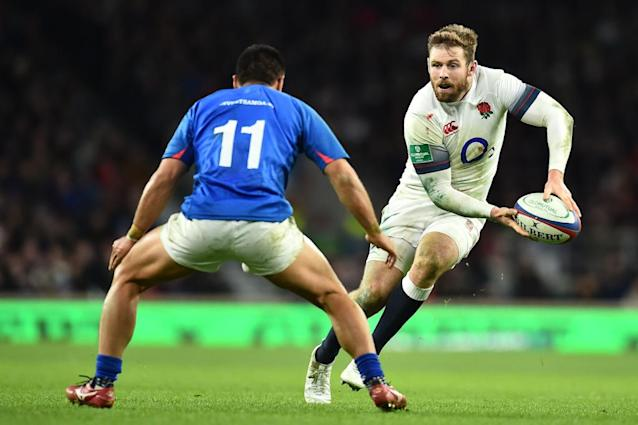 England's wing Elliot Daly (R) holds the ball past Samoa's wing David Lemai during the autumn international rugby union test match between England and Samoa at Twickenham stadium in south-west London on November 25, 2017. (AFP Photo/Glyn KIRK )