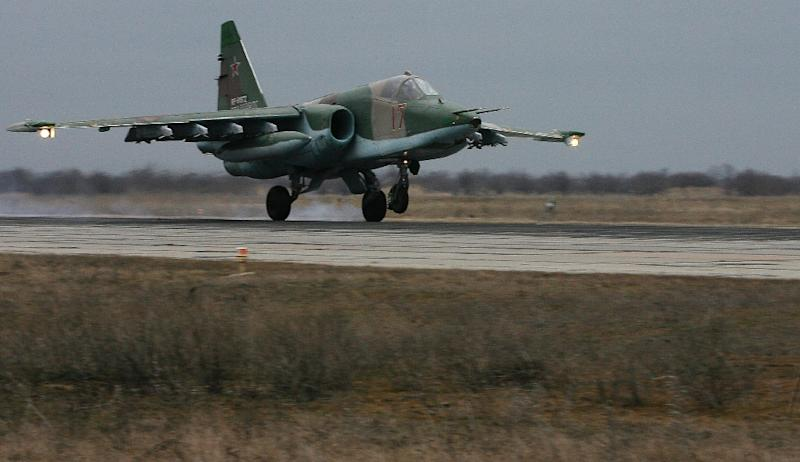 A Russian Air Force Su-25 SM attack plane takes off during a drill at Primorkso-Akhtarsk, Krasnodar region, on February 26, 2015 (AFP Photo/Sergey Venyavsky)