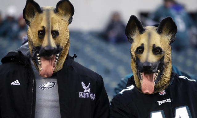 Dog masks have become popular in Philadelphia as Eagles fans have worn them to support their underdog team. (AP)