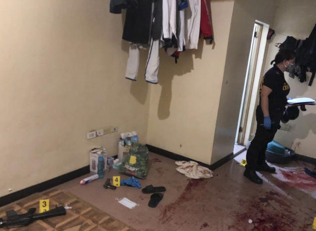 In this photo provided by the Philippine National Police NCRPO police inspect a hideout where four suspected Islamic State group-linked militants were killed during a gunbattle in metropolitan Manila Philippines Friday June 26 2020 Police and intelligence agents were to serve a search a warrant at a house in a village in suburban Paranaque city after months of surveillance when the suspected militants opened fire metropolitan Manila police chief Debold Sinas said Philippine National Police NCRPO via AP