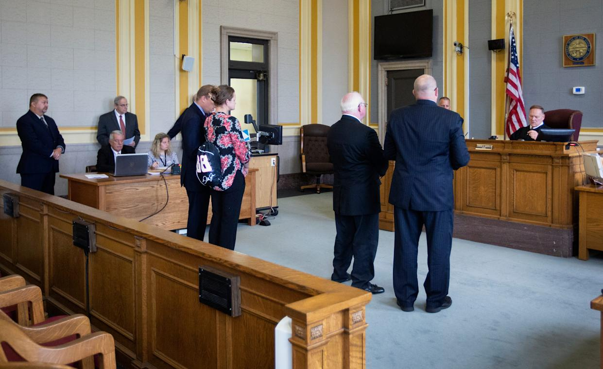 Kayla Artressia, 32, left, and Phil Malone, 64, stand with their attorneys in front of Scioto County Common Pleas Judge Howard Harcha August 22, 2019, for their arraignment on felony forgery and other charges stemming from Malone allegedly falsifying documents as a notary public for Artressia. Both were released on bond. Artressia has alleged a long sexual history with Malone dating back to when she was 15 and he 51. Malone is a former former Scioto County Sheriff's dispatcher and former probation officer. He was fired from both jobs. Several women have come forward accusing Malone of sexual misconduct. He denies all allegations. Rumors have long circulated in the small city of Portsmouth about men in power taking advantage of vulnerable women. Michael Mearan, prominent Portsmouth attorney, is part of an 80-page affidavit created by the Drug Enforcement Administration in 2015 to obtain permission to wiretap several phone, including Mearan's. It alleges he is part of a sex trafficking network.