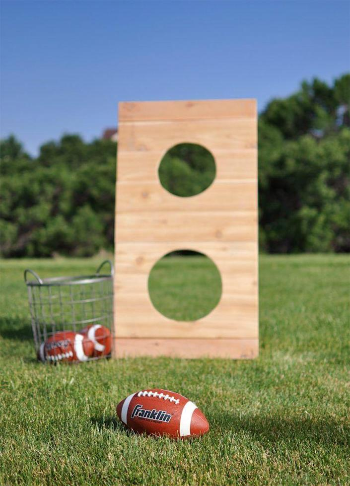 """<p>You can spend your day playing <a href=""""https://www.thepioneerwoman.com/home-lifestyle/crafts-diy/g32587510/picnic-games/"""" rel=""""nofollow noopener"""" target=""""_blank"""" data-ylk=""""slk:backyard games"""" class=""""link rapid-noclick-resp"""">backyard games</a> if the weather is nice this Father's Day. Make it even more special by crafting this football toss game ahead of time. </p><p><strong>Get the tutorial at <a href=""""https://cherishedbliss.com/diy-football-toss-outdoor-game-diy-workshop/"""" rel=""""nofollow noopener"""" target=""""_blank"""" data-ylk=""""slk:Cherished Bliss"""" class=""""link rapid-noclick-resp"""">Cherished Bliss</a>.</strong></p><p><a class=""""link rapid-noclick-resp"""" href=""""https://go.redirectingat.com?id=74968X1596630&url=https%3A%2F%2Fwww.walmart.com%2Fip%2FWilson-Reaction-NCAA-Football-Official%2F532577498&sref=https%3A%2F%2Fwww.thepioneerwoman.com%2Fholidays-celebrations%2Fg36333267%2Ffathers-day-activities%2F"""" rel=""""nofollow noopener"""" target=""""_blank"""" data-ylk=""""slk:SHOP FOOTBALLS"""">SHOP FOOTBALLS</a></p>"""