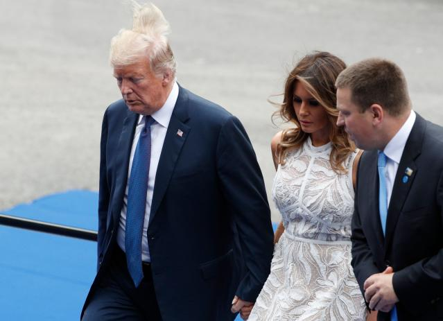 <p>President Trump walks with first lady Melania Trump and Estonian Prime Minister Juri Ratas as they arrive for a working dinner at the Parc du Cinquantenaire in Brussels on July 11, 2018, during the NATO summit. (Photo: Geoffroy Van Der Hasselt/AFP/Getty Images) </p>