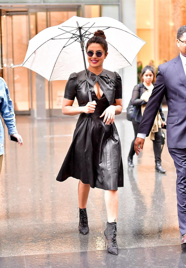 Proving you needn't wait until winter to pull off the trend, Priyanka Chopra took to the streets of New York in a leather bow-emblazoned dress - the perfect rain-proof look if you ask us. <em>[Photo: Getty]</em>