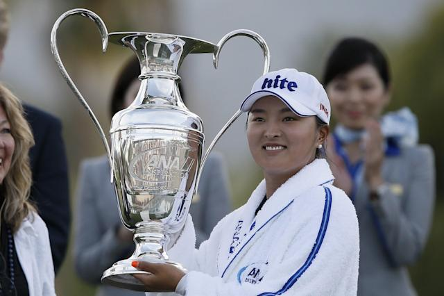 Jin Young Ko, of South Korea, poses with the Dinah Shore Trophy after winning the LPGA Tour ANA Inspiration golf tournament at Mission Hills Country Club in Rancho Mirage, Calif., Sunday, April 7, 2019. (AP Photo/Alex Gallardo)
