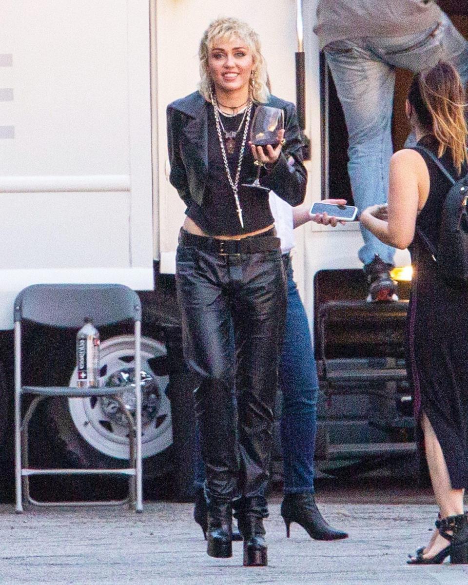 <p>Miley Cyrus sips on wine after a photoshoot in Burbank on Wednesday.</p>