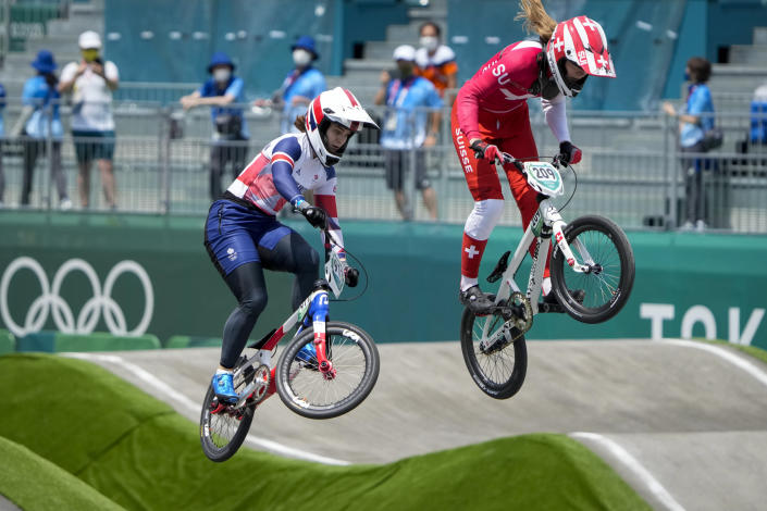 Bethany Shriever of Britain, left, and Zoe Claessens of Switzerland, right, compete in the women's BMX Racing quarterfinals at the 2020 Summer Olympics, Thursday, July 29, 2021, in Tokyo, Japan. (AP Photo/Ben Curtis)