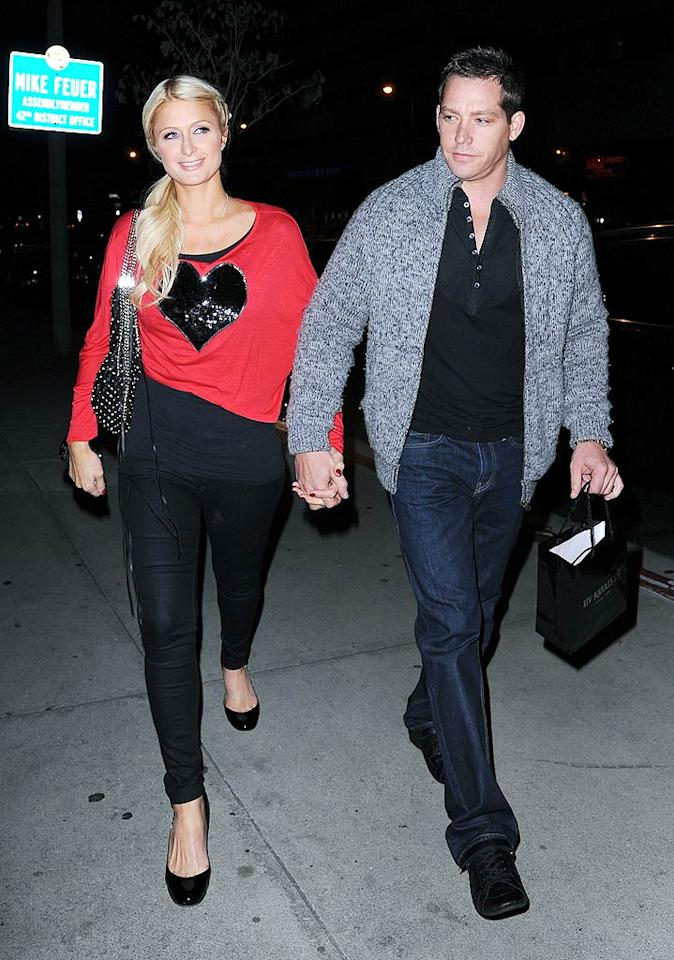 """Back in Los Angeles, Paris Hilton showed she has a big heart (on her Valentine's Day themed T-shirt at least) when she and her beau Cy Waits stepped out for a romantic dinner at BOA Steakhouse. VLUV/<a href=""""http://www.splashnewsonline.com"""" target=""""new"""">Splash News</a> - February 14, 2011"""