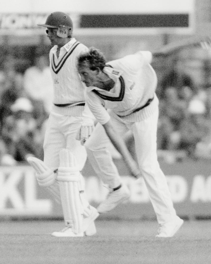 David Capel bowling past David Gower in 1990.