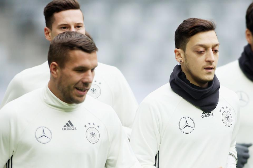 <p>Lukas Podolski and Mesut Ozil are former team-mates with both Arsenal and Germany</p> (Bongarts/Getty Images)